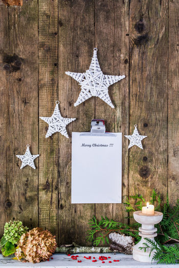 Christmas Decorations With Clipboard Hanging On Wooden Wall