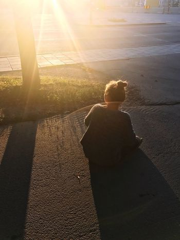 Sweden Stockholm Sunlight Real People Nature One Person Leisure Activity Lifestyles Men Lens Flare Sunbeam Sunset City Shadow Sitting Childhood Bright