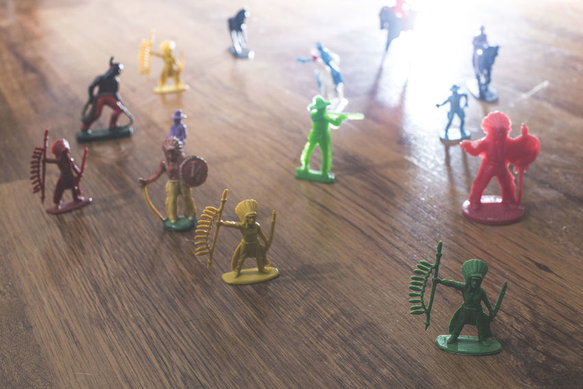 Toys Plastic Vintage People Indian Indians  Cowboy Batle Floor Table Still Life Representation Toy Wood - Material Indoors  Close-up Human Representation High Angle View Figurine  No People Focus On Foreground Creativity Male Likeness Art And Craft Group Large Group Of Objects Group Of Objects