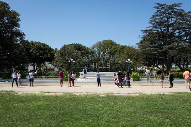 People in park against clear blue sky