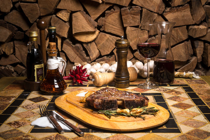 Beef Beef Steak Cooking Dinner Beefsteak Bottle Cutting Board Day Food Food And Drink Indoors  No People Plate Restaurant Serving Dish Spice T-bone T-bone Steak Table Wine