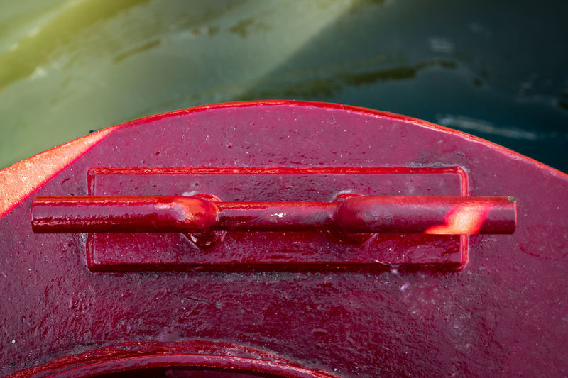 Close-up of red clamp on boat