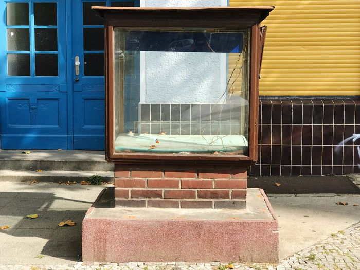 Empty street display box Commerce Empty Retail Display Architecture Building Exterior Built Structure Window Building Day Entrance No People Sunlight Glass - Material Outdoors City Residential District Wall Security Wall - Building Feature