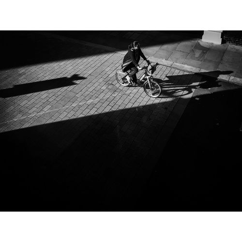 Shadow of person riding bicycle