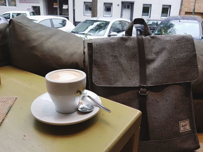 Have a break have a coffee Coffee - Drink Coffee Cup Table Drink Food And Drink No People Cappuccino Barista Break Leisure Activity Fashion Herschelsupply Backpack Rucksack Bag The Week On EyeEm Window EyeEm Best Shots Freshness Ready-to-drink View On The Table Latte Saucer Cafe