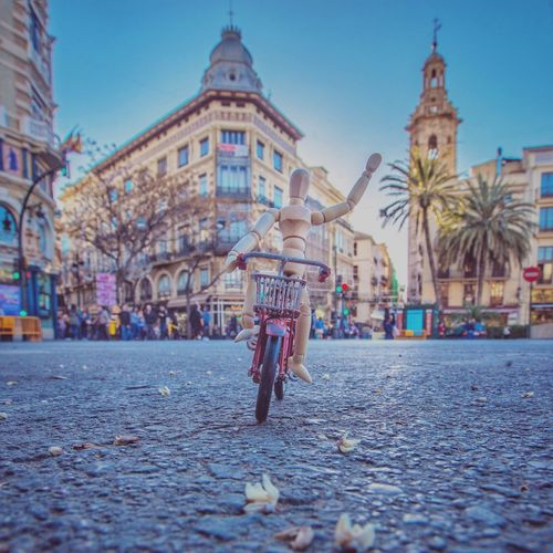 Riding bike in Valencia València Woodyforest Travel Destinations Riding Bike City Architecture Building Exterior Street Built Structure Real People Day One Person Lifestyles The Traveler - 2019 EyeEm Awards