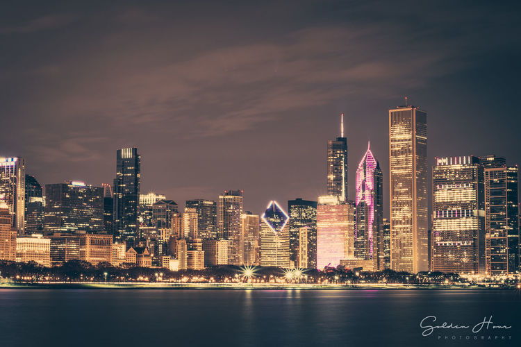 Long Exposure shot of the Chicago Skyline from the Adler Planetarium Adler Planetarium Chicago Chicago Skyline Architecture Building Built Structure City Cityscape Cloud - Sky Financial District  Long Exposure Modern No People Sky Skyscraper Tall - High Urban Skyline Water Waterfront