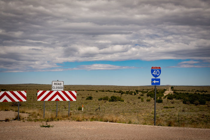 New Mexico, USA Prairie Scenes Cloud - Sky Communication Day Horizon Over Land Horizontal Symmetry Interstate 40 No People Outdoors Road Closed Sign Road Sign Sky Text Transportation