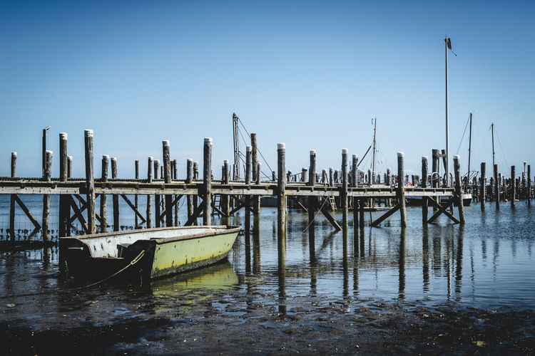 Anchored Architecture Clear Sky Copy Space Day Fishing Boat Marina Mode Of Transportation Moored Nature Nautical Vessel No People Outdoors Pole Port Post Sailboat Sea Sky Tranquility Transportation Water Waterfront Wood - Material Wooden Post
