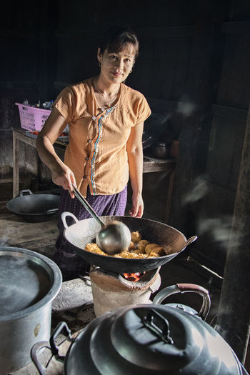Woman cooking,