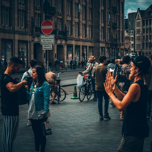 People photographing on street in city