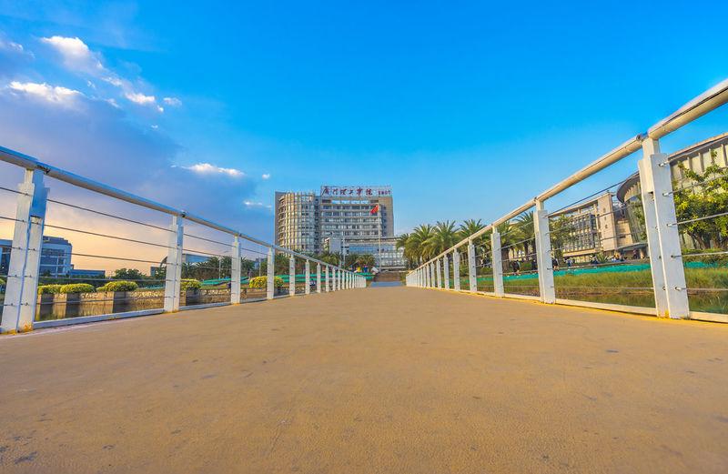 Walkway against sky