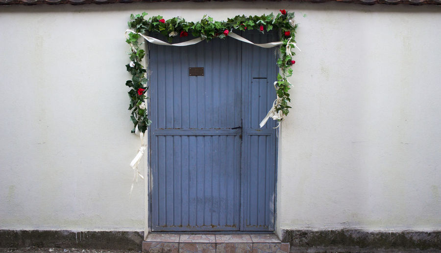 Celebration Discover Your City Green Color Wedding Architecture Blue Building Exterior Built Structure Celebrate Closed Day Door Doorway Europe Flower Greenery Growth House Nature No People Open Outdoors Plant Roses Travel Destinations