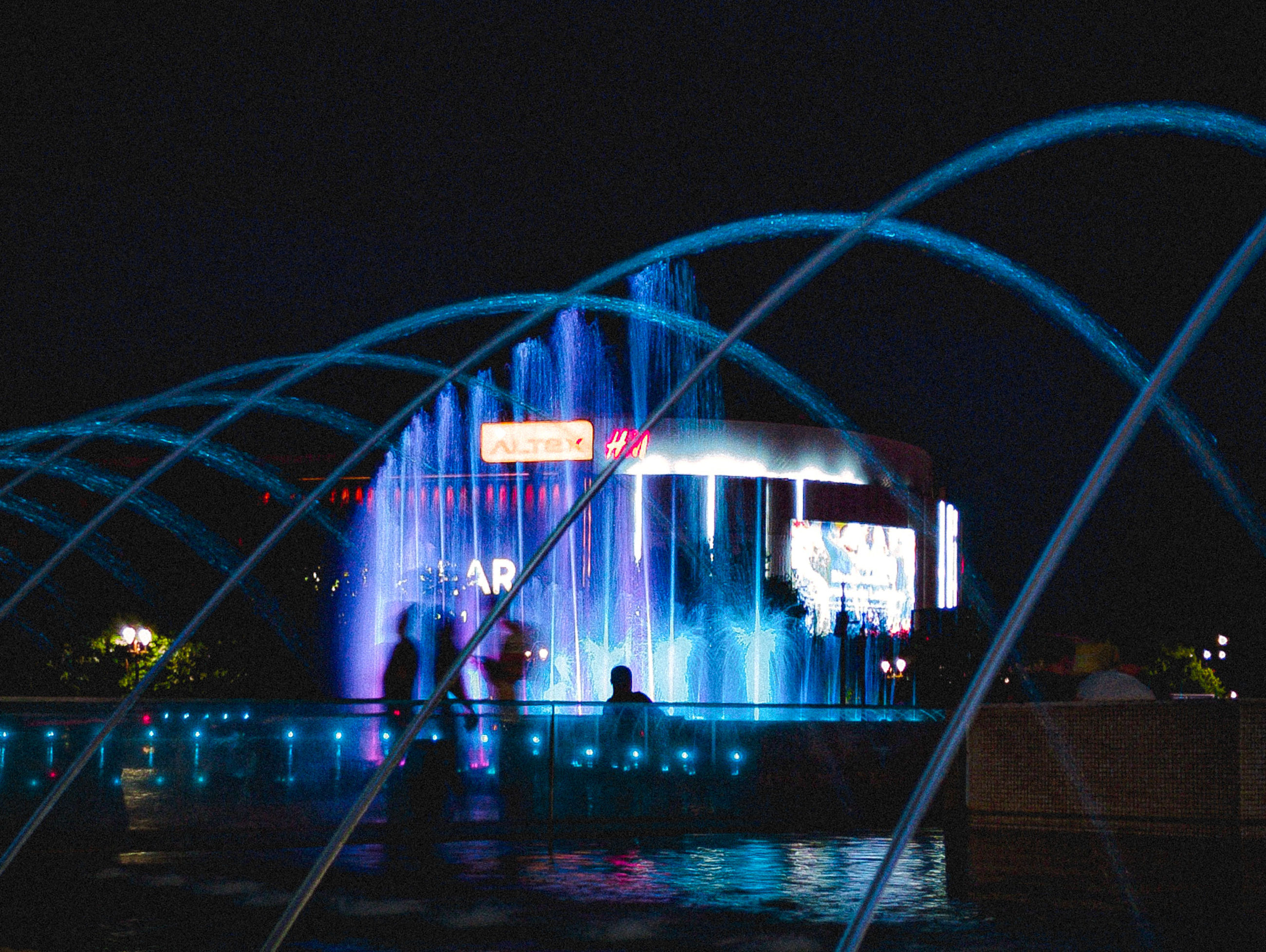 night, illuminated, architecture, light, stage, arts culture and entertainment, built structure, water, group of people, nature, building exterior, darkness, city, travel destinations, outdoors, lighting equipment, reflection, performance, sky