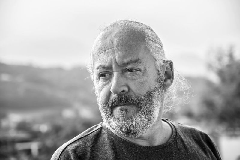 Portrait of man against blurred background