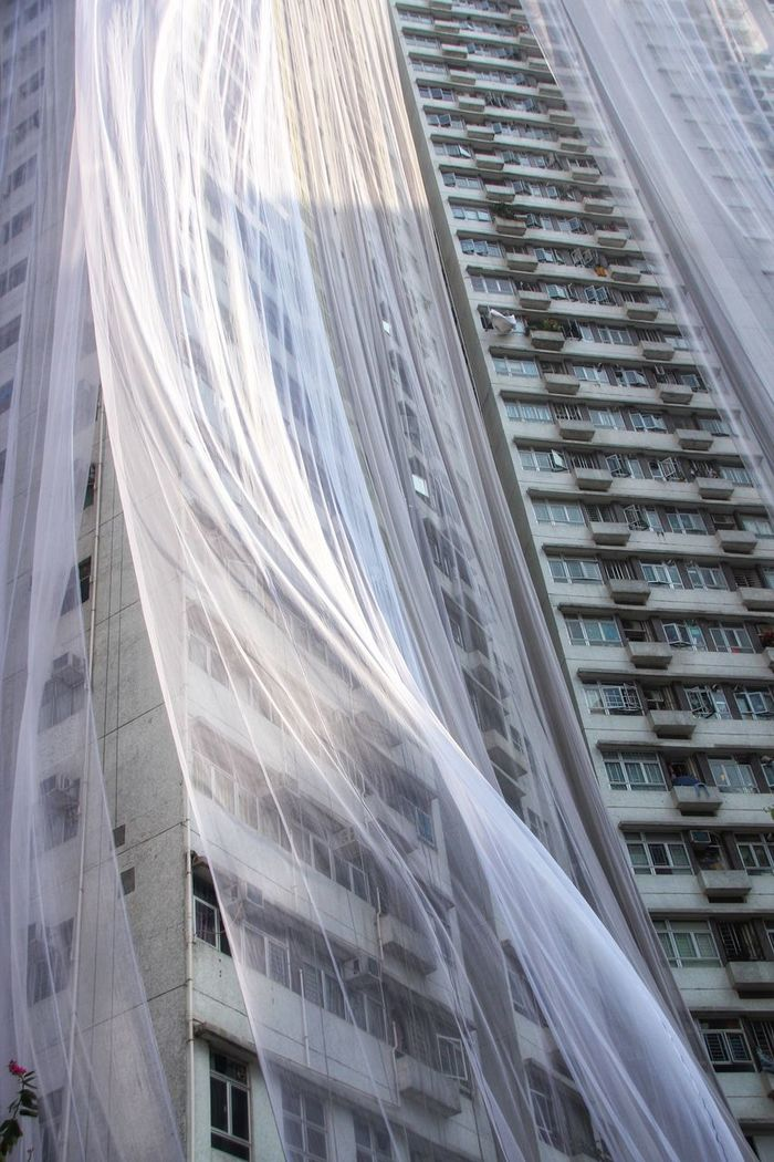 Aerial view of modern building covered with lace in city
