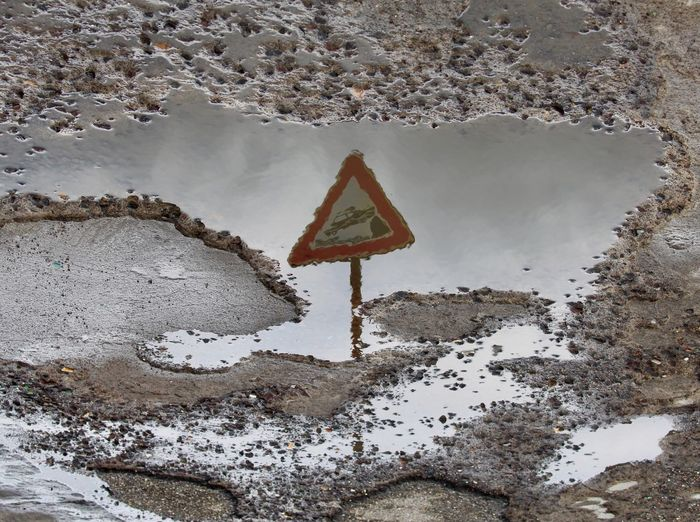 Road sign by water