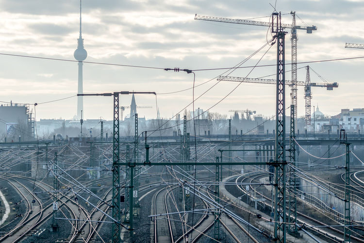 Skyline Clouds And Sky Misty Morning Rails TV Tower Cityscape Transportation Railway Track Railway Public Transportation Misty Cranes Dust Confusion Railroad Track Complexity Mode Of Transport Logistics Berlin Love Electricity Pylon Logistic The Street Photographer - 2017 EyeEm Awards Krull&Krull Images It's About The Journey 2018 In One Photograph