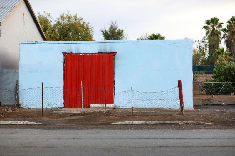 Britstown Building Exterior Door Boundary Outdoors No People Built Structure Day Architecture Fence Farm Town Farming Region Village Early Morning Outbuilding Red Britstown Britstown, South Africa Streetphotography Street