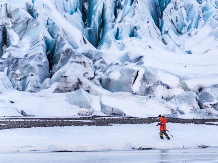 Man hiking in snowy landscape