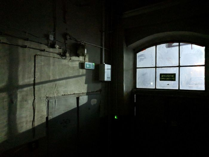 Emergency exit in old factory. Indoors  Light And Shadow Door Shadow Window Emergency Exit Window Architecture Built Structure Building Exterior Exit Sign Emergency Sign Building