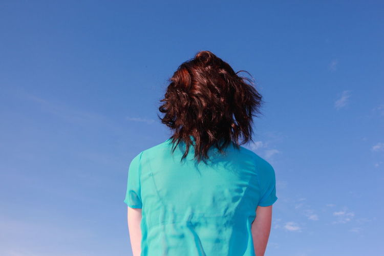 Rear view of woman against sky