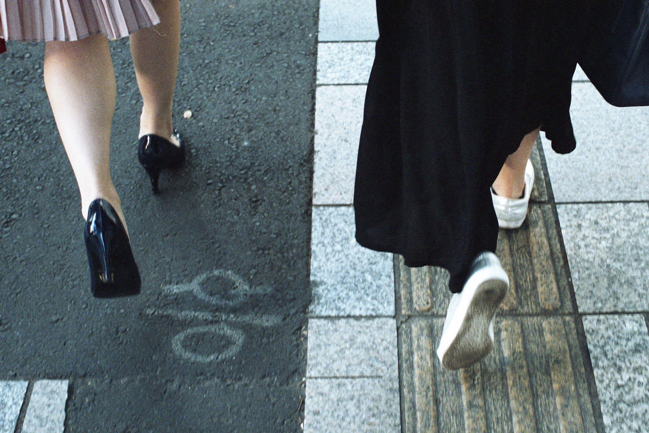 low section, person, lifestyles, walking, standing, street, shoe, shadow, leisure activity, high angle view, human foot, men, sidewalk, tiled floor, footwear, sunlight