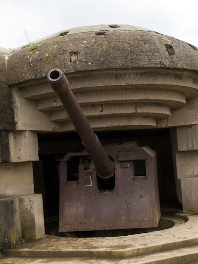 Gun in placement Omaha Beach Normandy France Ancient Architecture Circle Geometric Shape Historic History No People Old Old Ruin Omaha Beach Outdoors Shore Battery Steps Stone Material World War II
