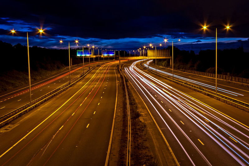 Light trails on the M60 near Sale, Manchester Blue Blue Sky Diminishing Perspective Dusk Electric Light Golden Hour Illuminated Journey Light Trail Lit M60 Manchester Motion Motorway Night Outdoors Road Sky Speed Tail Light The Way Forward Traffic Transportation