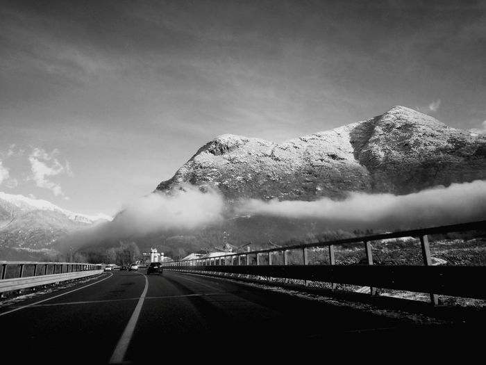 Alpine Mountains Travels Traveller Black & White Blackandwhite Biancoenero EyeEm Selects Mountain Snow Cold Temperature Winter The Way Forward Fog No People Outdoors Road Travel Destinations Day Sky Nature Steam Train