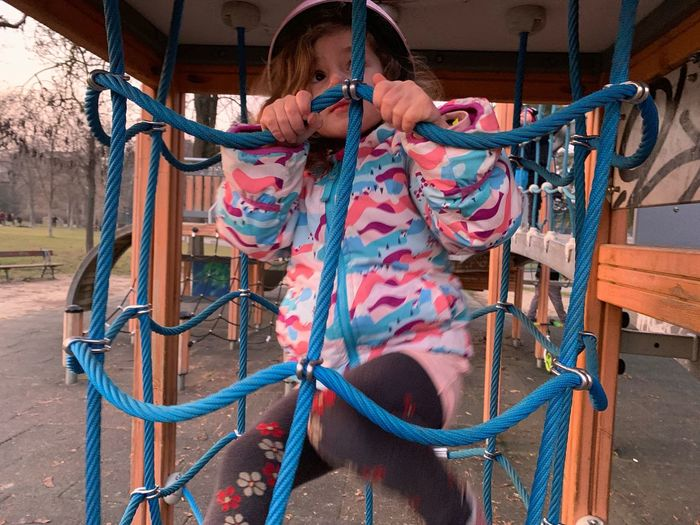 Playing Girl Sister Playground Equipment Playground EyeEm Selects One Person Real People Day Lifestyles Rope Livestock Outdoors