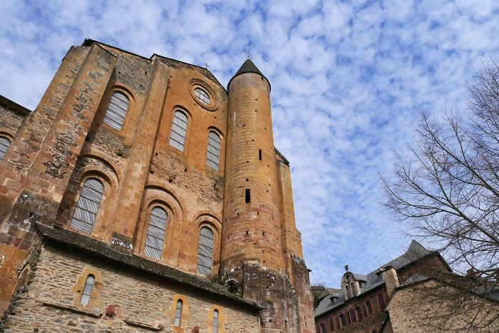 Abbatiale de Conques - Church Low Angle View Architecture Sky History Building Exterior Travel Destinations Medieval Occitanie Architecture Architecturephotography Old Architecture France Patrimoine Aveyron Old Town Tourism Church Architecture Pierre Soulages Stained Glass Vitraux Stained Glass Window Architecturelovers