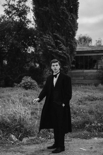 Young Man smoking a cigarette Smoke Adult Blackandwhite Cigarette  Field Front View Full Length Land Lifestyles Looking At Camera Nature One Person Outdoors Plant Portrait Portrait Photography Real People Standing Suit Three Quarter Length Tree Well-dressed Young Adult