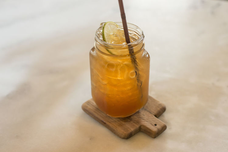 Food And Drink Drink Refreshment Freshness Food Drinking Straw Straw Jar Table Glass Wood - Material No People Glass - Material Container Wellbeing Drinking Glass Close-up Household Equipment Iced Lemon Tea