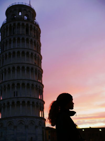Low angle view of woman tower against sky