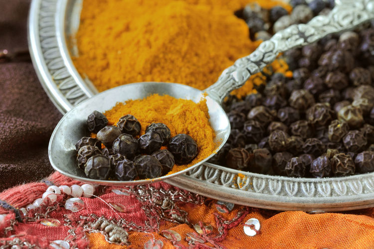 Turmeric and black pepper combination has great heath benefits Cooking India Indian Natural Obesity Antioxidant Aroma Black Closeup Curcumin Diabetes Food Grain Healthy Ingredient Macro Nutrition Organic Pepper Powder Seasoning Spices Turmeric  Vegan Vitamin