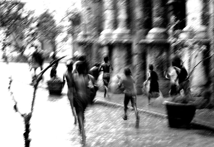 Boys running out in the rain to play soccer. Awkward Moments B/W Photography Motion Blur No Edit/no Filter Havanna, Cuba, 2014