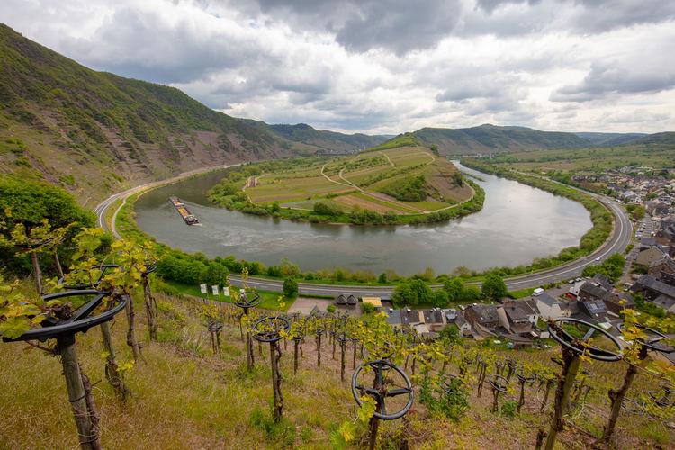 Mosel horse shoe bow and wine plants in Bremm, Rheinland-Pfalz, Germany, May 2019 Germany Mosel Moselschleife Bremmer Calmont Cloud - Sky Scenics - Nature Beauty In Nature Tranquil Scene Sky Environment Mountain Landscape Tranquility Nature Day Non-urban Scene No People Water Plant Road Outdoors Bremm River Transportation Idyllic Mountain Range Barrier
