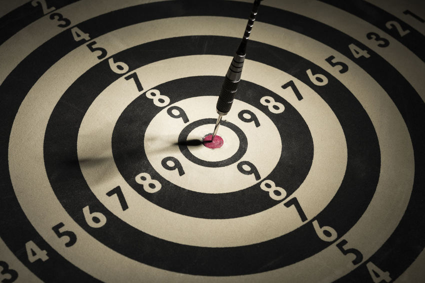 Dart in bulls eye of dartboard Achieve Achievement Aspirations Business Skill  Target Accuracy Aim Aiming Backgrounds Bulls Eye Competition Concept Dart Dartboard Focus Fortune Perfection Performance precision Scoring Sports Target Strategy Success Winner