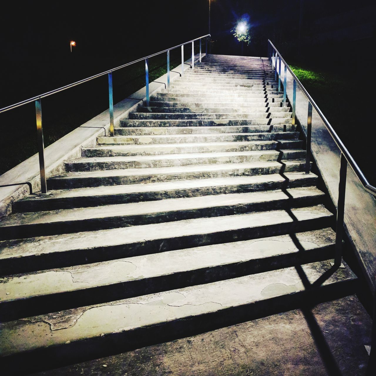railing, steps, steps and staircases, night, staircase, the way forward, shadow, no people, outdoors, illuminated, hand rail, nature, sky