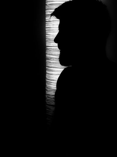 Close-up portrait of silhouette woman at home