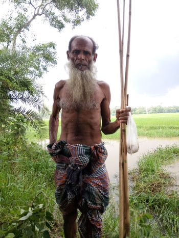 Shirtless Only Men One Man Only One Person Outdoors People Tree Water Adult Day Portrait Adults Only Nature Mammal Sky Reflection Growth Good First Eyeem Photo Freshness Beauty In Nature No People Rural Scene Rice Paddy Focus On Foreground
