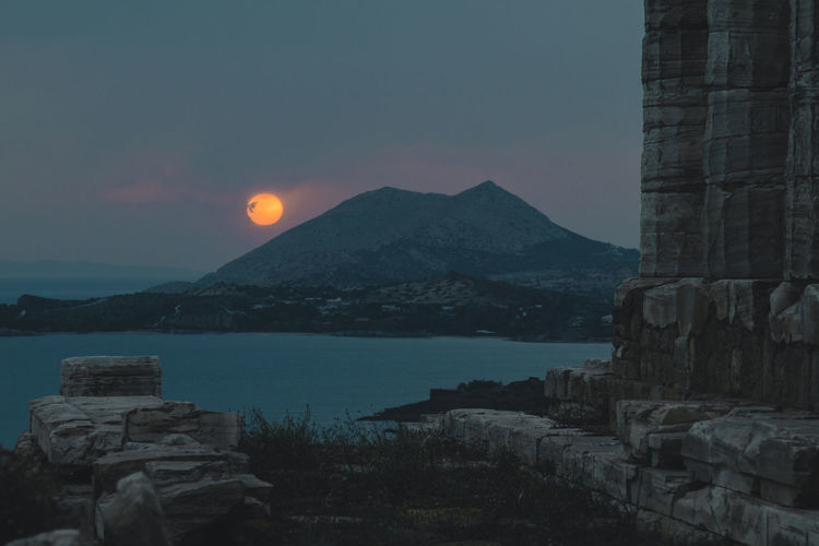 Architecture Beauty In Nature Building Exterior Built Structure Clear Sky Greece Idyllic Mountain Mountain Range Nature No People Non-urban Scene Rock Scenics - Nature Sea Sky Sun Sunset Temple Tranquil Scene Tranquility Water