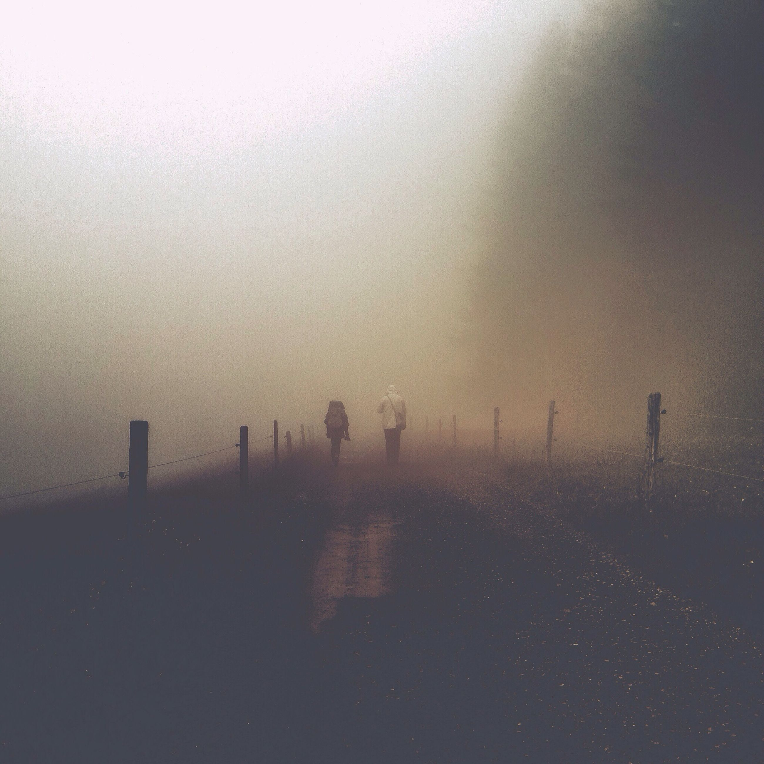 fog, silhouette, tranquility, sky, tranquil scene, foggy, copy space, weather, walking, nature, scenics, water, unrecognizable person, the way forward, beauty in nature, sea, dusk, men, sunset