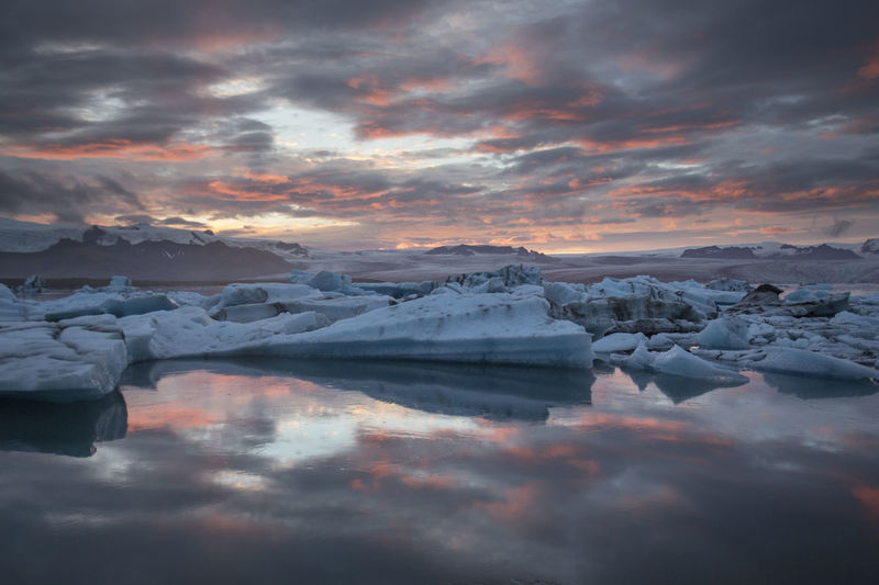 Glacier Lagoon in South east Iceland Iceland Jökulsárlón Beauty In Nature Cold Temperature Glacier Glacier Lagoon Ice Iceberg Icelandic Jokul Nature No People Outdoors Scenics Sky Sunset Tranquil Scene Tranquility Water Winter
