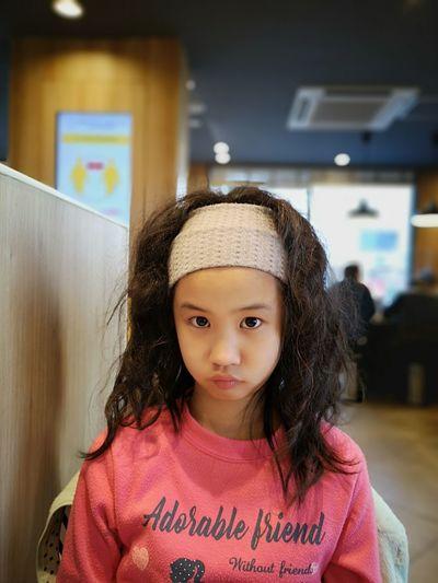 Portrait of cute girl in cafe