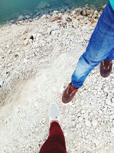 Step It Up Low Section Human Leg Shoe Human Body Part Human Foot Real People Standing One Person Jeans Lifestyles Leisure Activity Men Day Red Sand Women Only Men People Adult Outdoors
