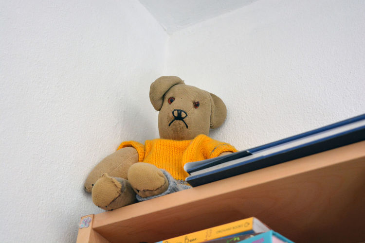 Sad old teddy bear, abandoned on top shelf Abandoned Antique Child's Bedroom Childhood Forgotten Memories Old Toys Out Of Reach Sad & Lonely Sad Face Stuffed Animals Stuffed Toy Teddy Teddy Bears Throwback Thursday Top Shelf Toy Bear Toys Unloved Toys Vintage