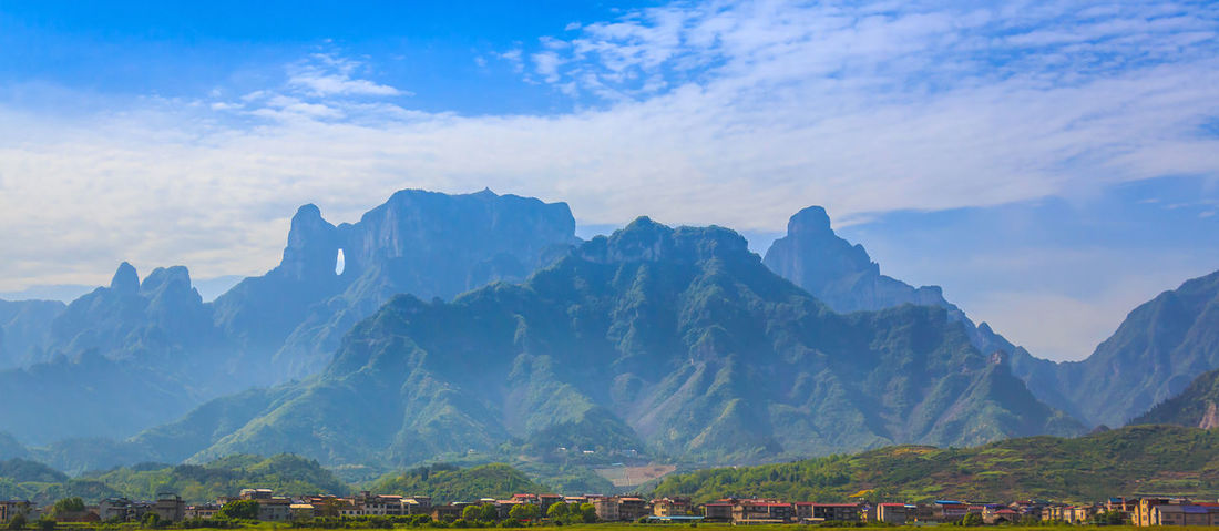 Amazing View Changsha Gate Heaven National Park Rocky Tianmen Mountain Travel Beauty In Nature Cave Cavity China Chinese Famous Place Hole Landmark Landscape Mountain Nature Outdoors Popular Photos Range Sky Travel Destinations Zhangjiajie