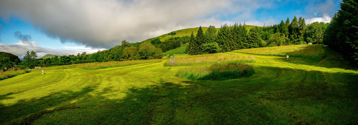 Disc golf course panorama at Loch Tay Highland Lodges, central Scotland Family Golf Loch Tay Nature Perthshire Scotland Tourist Attraction  Activity Basket Cloud - Sky Course Disc Fairway Flying Hill Hole Lake Lake View Landscape Scottish Highlands Sports Summer Travel Destination Travel Destinations